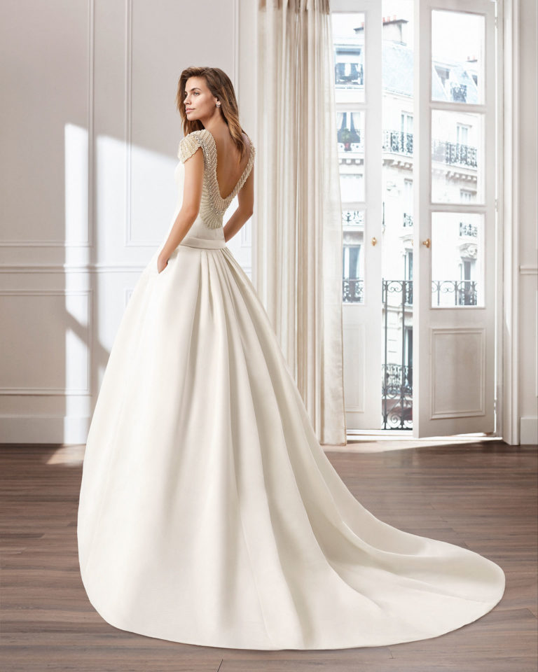 Classic A-line ottoman wedding dress. Bateau neckline and jewelled back. Available in natural. 2019  Collection.